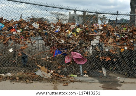 BROOKLYN, NY - NOVEMBER 01: Water level at fences after flood at Seagate neighborhood due to impact from Hurricane Sandy in Brooklyn, New York, U.S., on Thursday, November 01, 2012. - stock photo