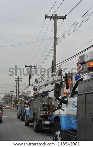 BROOKLYN, NY - NOVEMBER 11: Working out power problems in the Rockaway due to impact from Hurricane Sandy in Queens, New York, U.S., on November 11, 2012. - stock photo