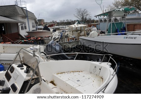 BROOKLYN, NY - OCTOBER 30: Boats smashed to the ground in the Sheapsheadbay neighborhood due to flooding from Hurricane Sandy in Brooklyn, New York, U.S., on Tuesday, October 30, 2012. - stock photo