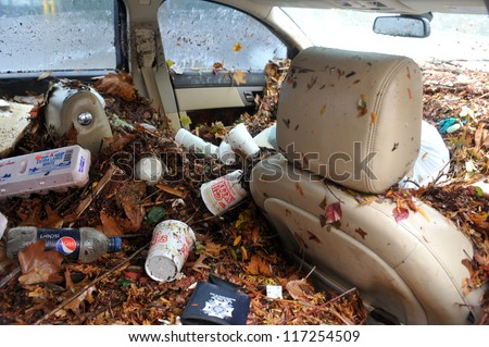 BROOKLYN, NY - OCTOBER 30: Debris litters inside abandoned cars in the Sheapsheadbay neighborhood due to flooding from Hurricane Sandy in Brooklyn, New York, U.S., on Tuesday, October 30, 2012. - stock photo