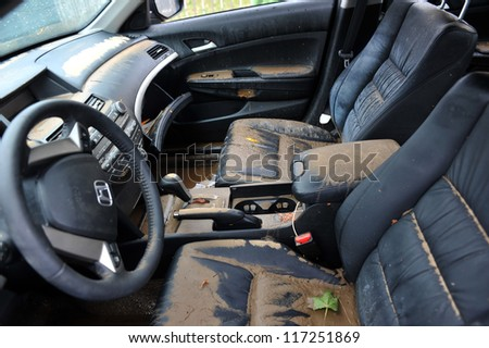 BROOKLYN, NY - OCTOBER 30: Debris litters inside abondoned car in the Sheapsheadbay neighborhood due to flooding from Hurricane Sandy in Brooklyn, New York, U.S., on Tuesday, October 30, 2012. - stock photo