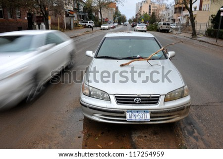 BROOKLYN, NY - OCTOBER 30:Debris litters on top of abandoned car in the Sheapsheadbay neighborhood due to flooding from Hurricane Sandy in Brooklyn, New York, U.S., on Tuesday, October 30, 2012. - stock photo