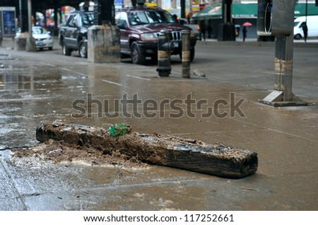 BROOKLYN, NY - OCTOBER 30: Debris litters the ground in the Brighton Beach avenue due to flooding from Hurricane Sandy in Brooklyn, New York, U.S., on Tuesday, October 30, 2012. - stock photo