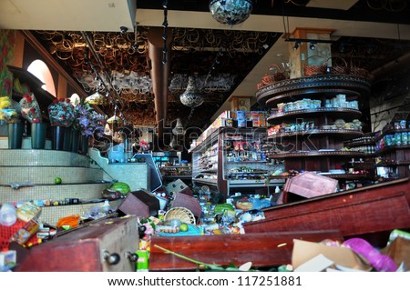 BROOKLYN, NY - OCTOBER 30: Demolition inside a food store damaged in the Sheapsheadbay neighborhood due to flooding from Hurricane Sandy in Brooklyn, New York, U.S., on Tuesday, October 30, 2012. - stock photo