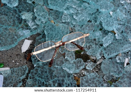 BROOKLYN, NY - OCTOBER 30: Dropped eyeglasses on the ground in the Sheapsheadbay neighborhood due to flooding from Hurricane Sandy in Brooklyn, New York, U.S., on Tuesday, October 30, 2012. - stock photo