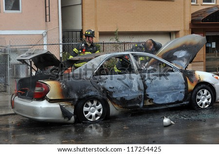 BROOKLYN, NY - OCTOBER 30: Fire department people fought fire in the Sheapsheadbay neighborhood due to flooding from Hurricane Sandy in Brooklyn, New York, U.S., on Tuesday, October 30, 2012. - stock photo