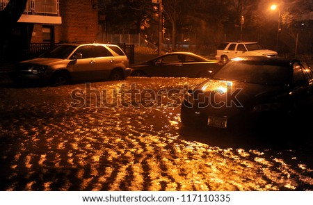 BROOKLYN, NY - OCTOBER 29: Flooded streets, caused by Hurricane Sandy, are seen on October 29, 2012, in the corner of Bragg street and  Shore Pway of Brooklyn NY, United States. - stock photo