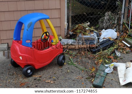 BROOKLYN, NY - OCTOBER 30: Kid toy and debris litters the ground in the Sheapsheadbay neighborhood due to flooding from Hurricane Sandy in Brooklyn, New York, U.S., on Tuesday, October 30, 2012. - stock photo