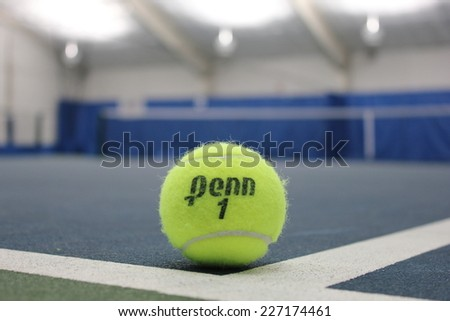 BROOKLYN, NY - OCTOBER 5: Penn tennis ball at indoor court in Brooklyn on October 5, 2014. Penn tennis balls produced by Head sports equipment and clothing company. - stock photo