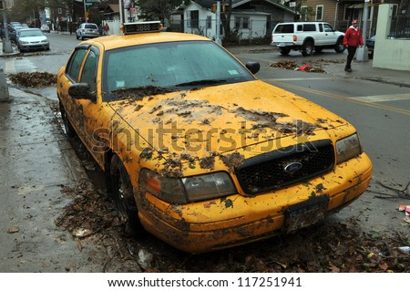 BROOKLYN, NY - OCTOBER 30: Yellow cabs all in mud in the Sheapsheadbay neighborhood due to flooding from Hurricane Sandy in Brooklyn, New York, U.S., on Tuesday, October 30, 2012. - stock photo