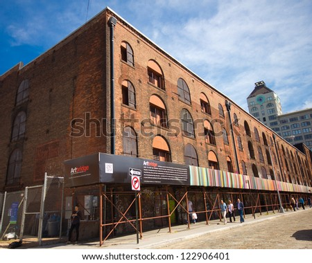 BROOKLYN, NY - SEPT 16:  Historic Empire Stores building with Chromatweet Artbridge installation in DUMBO Brooklyn on Sept 16, 2012. Macasev�s ChromaTweet was part of  the Dumbo Arts Festival in 2011. - stock photo