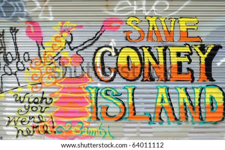 BROOKLYN - OCTOBER 25: Graffiti referring to Coney Island's historic amusement parks threatened by urban renewal October 25, 2010 in Brooklyn, New York. - stock photo