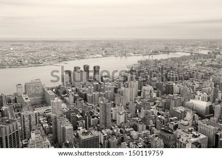 Brooklyn skyline Arial view from New York City Manhattan with Williamsburg Bridge over East River and skyscrapers black and white - stock photo