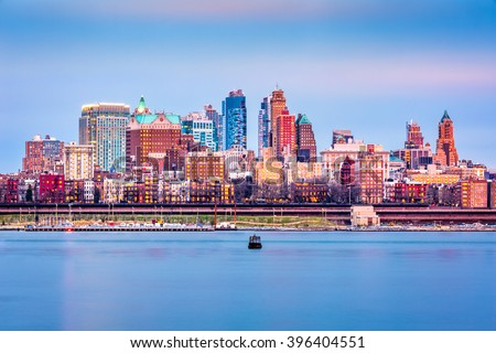 Brooklyn skyline glows under the sunset light. - stock photo