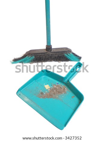 broom and dustpan full of dirt after a sweeping