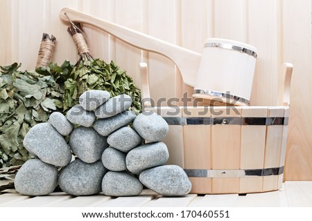 Broom, bucket, sauna stones and bath accessories. - stock photo