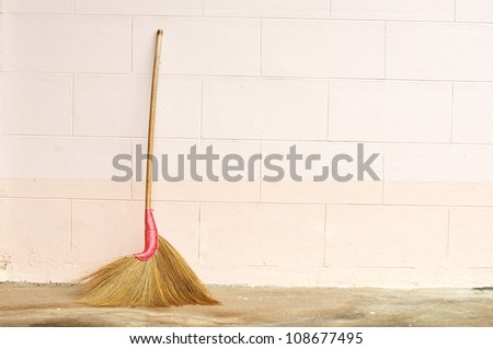 broom contrasting the tiled floor