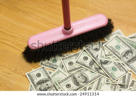 Broom, floor, heap of dollars - stock photo