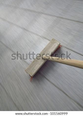 broom sweeping  - long exposure time - stock photo