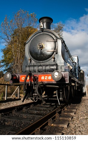BROOMHILL, SCOTLAND - OCT 7: Caley 828, the world's only surviving Caledonian Railway's  0-6-0 tender locomotive on October 7, 2012 in Broomhill, Scotland - stock photo