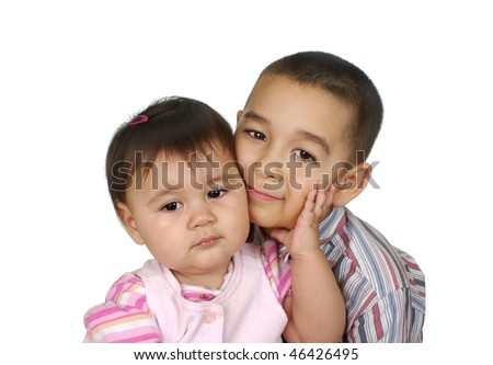 Brother and baby sister together, six years old and one year old, isolated on white background - stock photo