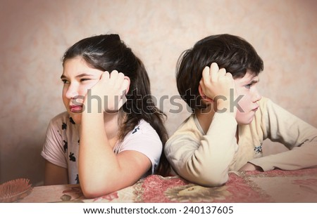 brother and sister after quarreling - stock photo