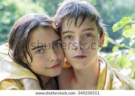 brother and sister after swimming - stock photo