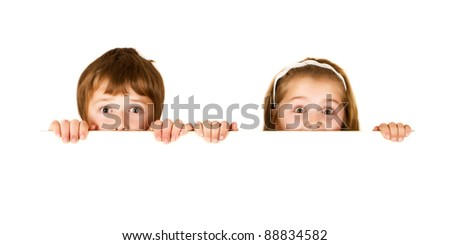 Brother and sister are holding empty white board - stock photo