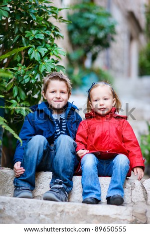 Brother and sister at narrow street in Dubrovnik Croatia - stock photo