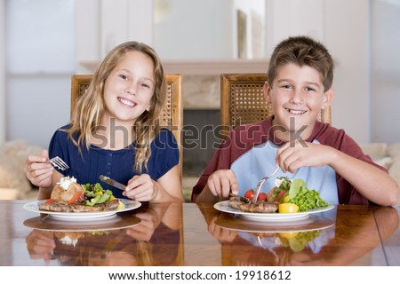 Brother And Sister Eating meal,mealtime Together - stock photo
