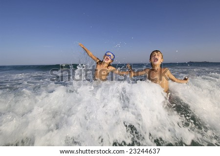 Brother and sister having fun in the sea