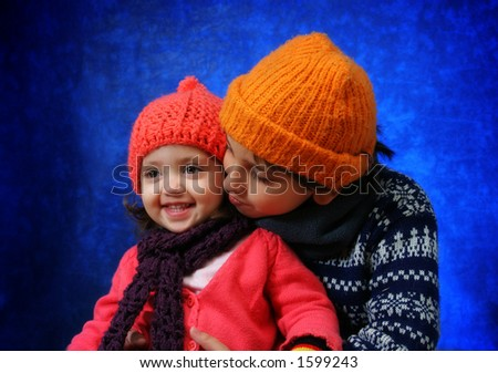 Brother and sister having fun in winter outfit.