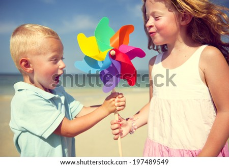Brother and Sister having fun on the Beach. - stock photo