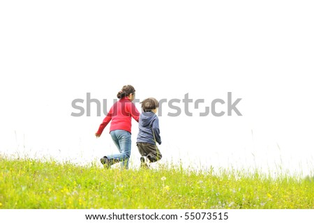Brother and sister in the nature, running together - stock photo