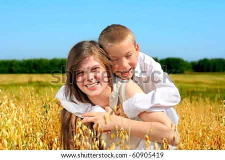 brother and sister in the wheat field - stock photo