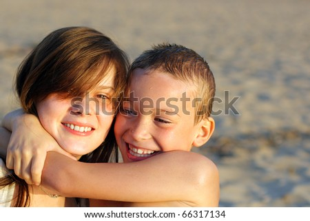 brother and sister on the evening beach