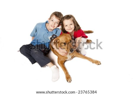 brother and sister or friends hugging their dog, isolated over white - stock photo