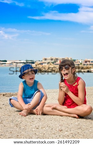 Brother and sister outdoors in port city - stock photo