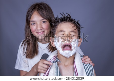 Brother and sister playing. - stock photo