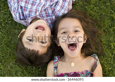 Brother and sister playing outside - stock photo