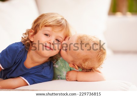 Brother And Sister Playing Outside Together - stock photo