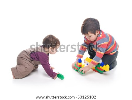 Brother and sister playing together over white background - stock photo