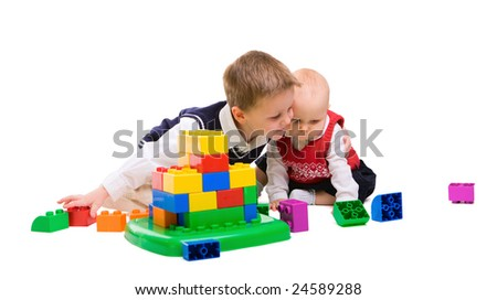 Brother and sister playing together with building blocks - stock photo