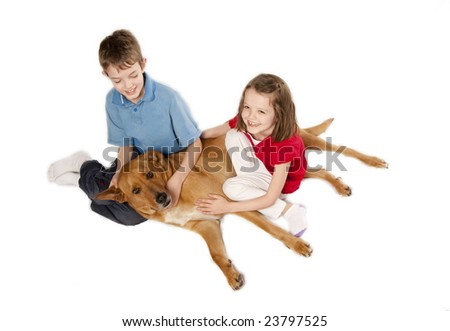 brother and sister playing with their dog, isolated over white - stock photo