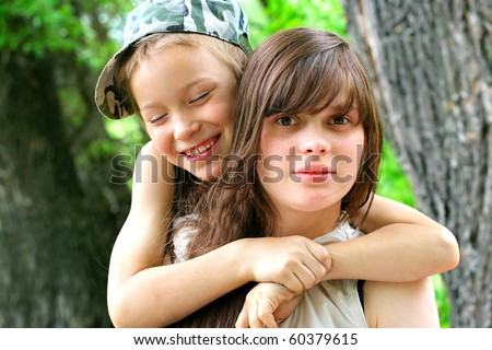 brother and sister portrait outdoor - stock photo