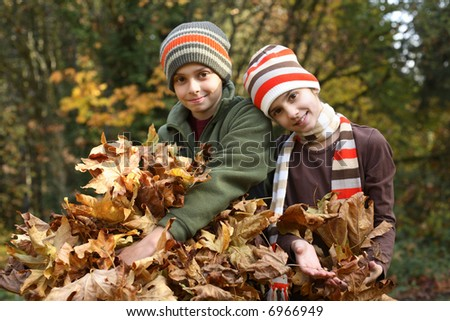 Brother and sister portrait with fall leaves
