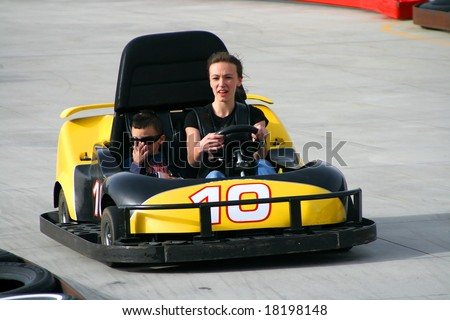 Brother and Sister racing on the Go Cart - stock photo