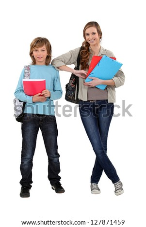 brother and sister ready for school - stock photo
