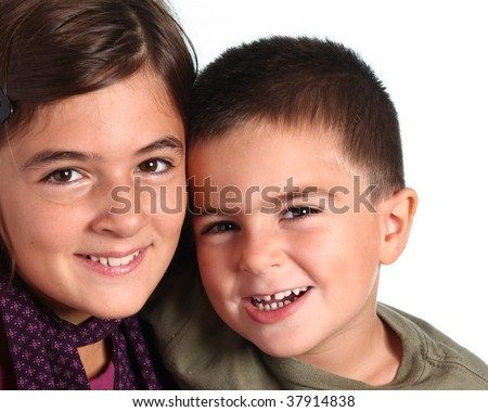 brother and sister smiling on white background - stock photo