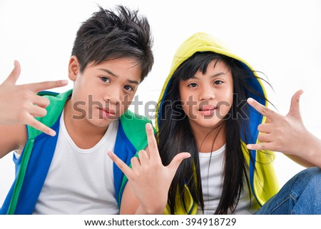 brother and sister together with hands gesture - stock photo